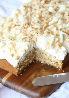 I need this RIGHT now.  White Chocolate Macadamia Nut Cake.. A simple brown sugar buttermilk cake with white chocolate frosting, topped with salty Macadamia Nuts!