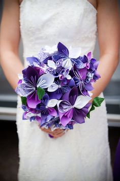 Paper wedding bouquet. on the cheap, and pretty. I think I could make these. Might take me a month but hey I have time.