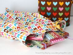 Easy tutorial for making two draw-string bags from one Fat Quarter! Perfect for gifts, storage and using up fabric stash.