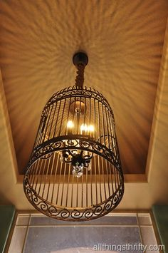 So now we have the look of the Restoration Hardware Birdcage Chandelier, but instead of paying $2300.00, it only cost right around $60 to recreate the whole thing. Now that's what I call THRIFTY!!!