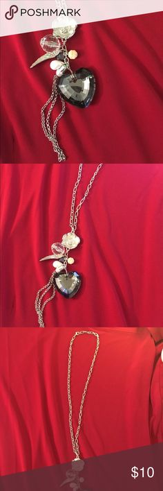 Cute  heart and angel wing necklace! Cute  heart and angel wing with flower and gemstone necklace! Is on a silver color chain all is faux . To cute with its small chain tassel. Measures 17 in chain. Jewelry Necklaces