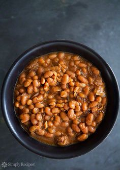 Slow cooked Boston baked beans, white beans cooked with salt pork and onions, in a molasses and mustard sauce. ~ SimplyRecipes.com