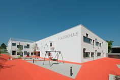 Childcare centre in Austria: The façade is developed as a 'pixeled' white envelope.