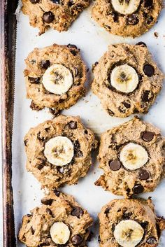 Looking down on a baking sheet filled with chunky monkey paleo banana cookies fresh out of the oven.