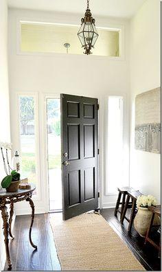 black door, sisal rug, little stools <3