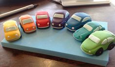 Could make a few little cars in different colours (as per pic) and then a block cake with the brand name on it?