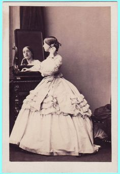 Civil War Era Lady gazing at her reflection in a mirror
