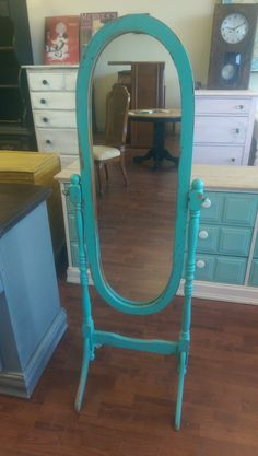 "I have a cute little dressing mirror available. I painted it a distressed turquoise. Super cute, what do you think? The dimensions are 18"" wide and 57"" tall. The mirror itself is 11"" wide and 38"" tall. SOLD!! for $75"