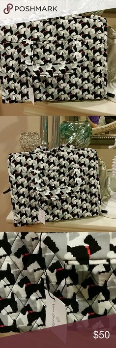 Vera Bradley Hanging Organizer New with tag Adorable Vera Bradley Organizer New with tag. Pattern is called Scottish Dogs. This piece can hold alot.  Organizer has a handle and ties on top. Organizer has a handle so you can hang it anywhere. Zipper pockets inside with also plastic zipper pockets to hold toiletries. This piece is a must. 4 good size pockets to hold toiletries, jewelry, makeup etc.... For additional information please ask questions.  . Vera Bradley Bags Cosmetic Bags & Cases