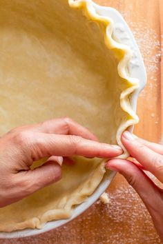 "This homemade pie crust recipe yields a flaky tender crust with rich buttery flavor. It has simple, natural ingredients and uses only butter (NO SHORTENING). Learn how to roll and transfer pie dough, form a fluted pie rim, ""blind bake"" or pre-bake pie crust and discover surprisingly simple alternatives for pie weights. 