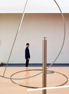 Inside the Lexus installation at Milan Design Week 2016: Andrea Trimarchi alongside the lights.