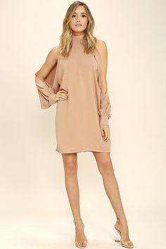 The Under Your Spell Blush Long Sleeve Dress will make everyone follow your fashion lead! Lightweight woven poly shapes a mock neck and long, billowing sleeves with slits and buttoned cuffs. Shift silhouette. Hidden back zipper/clasp.