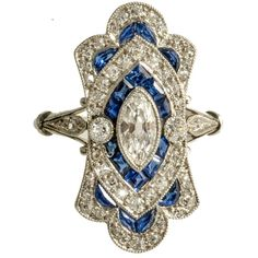 Art Deco Diamond and Calibre Sapphire Natural Marquese Platinum Ring, circa 1920 | 1stdibs.com