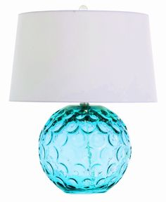 arteriors caprice lamp -   Bands of concave circle insets dot the surface of this ball shaped aqua glass lamp.