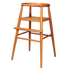 a gorgeous danish modern child high chair - no strap, totally impractical but a beauty. $900