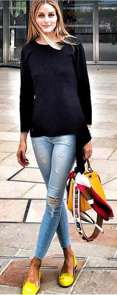 Who made Olivia Palermo's yellow shoes, blue ripped jeans, yellow handbag, and black sweater?