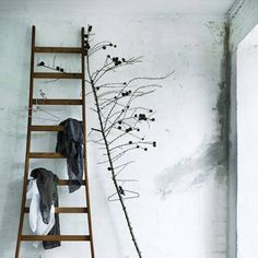 an old ladder for the clothes that you've worn but aren't dirty. love this shop/design