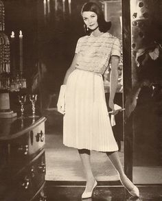 Anne St Marie wearing an ensemble by Larry Aldrich, 1959.