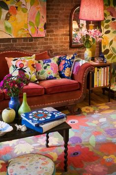Fun mix with antique sofa and contemporary florals in art and accessories.
