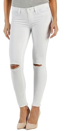 Unfinished hems and ripped knees put a laid-back vibe on streamlined white skinny jeans. Paige Denim 'Verdugo' Ankle Skinny Jeans (White Mist Destructed)