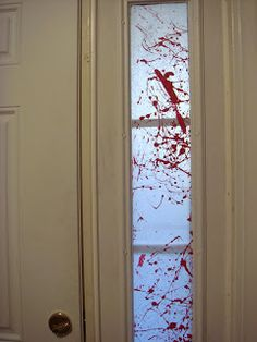 bloody good zombie party decor tutorial. it's just wax paper and paint