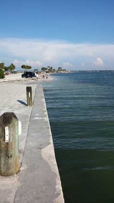 Foot of the causeway bridge in Dunedin, FL Great Places, Places To See, Honeymoon Island, Clearwater Beach, Florida Beaches, Things To Do, Palm, Bridge, Sidewalk