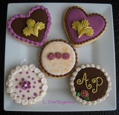My first sold sugar cookies decorated in royal icing. Vintage inspired, ivory, brown and fuchsia, fleur de lis, wet on wet, rosettes, initials and more~Leslie