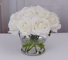 Simple, beautiful floral arrangement with white roses in faux water. Perfect for a coffee table, night stand, end table, office desk or as a gift. Beautifully hand crafted in the U.S, with premium quality, realistic, silk/artificial flowers in the Real Touch category. Real Touch