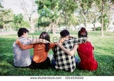teen group people sitting and hug in a park, friendship teenager concept.
