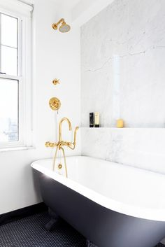 LOVE this ledge/shelf | 14 Stunning Bathrooms to Inspire Your Next Renovation via @MyDomaine