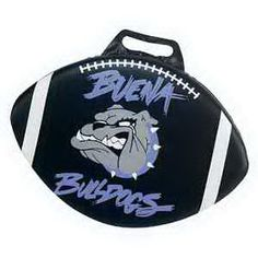 """Get them comfortable with your logo using this sporty giveaway! A great fundraiser item for your school, team or organization, our football shaped seat cushion is a fun way to show support. Available in 1"""" thickness, your name, logo or custom design is showcased on one side. Made of 100% reusable vinyl material, each 15 1/2"""" x 11"""" item is available in an array of colors to match your branding needs. Proudly made in the USA."""