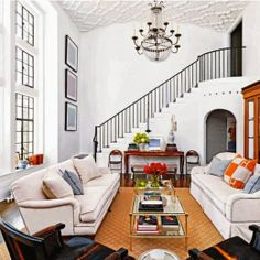 Simple Details: a collection of ideas for decorating two story walls... Large scale art, large light fixture, large armoire, large scale furniture.