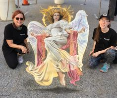 3D chalk art by Jennifer and Mercedes Chaparro at Little Italy Madonnari Festival in Baltimore, Maryland, 2017.  Original art (Uriel) by Tguyoshi Nakano, copyright Applibot, Inc, Legends of the Cryptids. #3dchalk #3d #3dstreetpainting #angel #uriel #Baltimore #archangel #cryptids #tguyoshinakano #sidewalkchalk #madonnari #festival