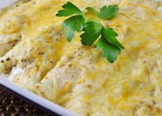 Enchiladas Suizas Recipe - Corn tortillas rolled up with shredded chicken and 2 kinds of cheese, and then served with a zesty salsa verde. This dish can also be made with cooked pork or beef. Recipes Using Rotisserie Chicken, Leftover Rotisserie Chicken, Chicken Recipes, Turkey Recipes, Turkey Meals, Chicken Ideas, Mexican Dishes, Mexican Food Recipes, Dinner Recipes