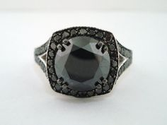 Hey, I found this really awesome Etsy listing at https://www.etsy.com/listing/95990516/400-carat-fancy-black-diamond-engagement