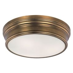 Fairmont Collection   Arched channels of metal finished in your choice of Natural Aged Brass or Polished Nickel, form this minimalistic approach to traditional lighting. Oatmeal fabric shades adorn the top of metal candle covers that give this collection a tailored look.