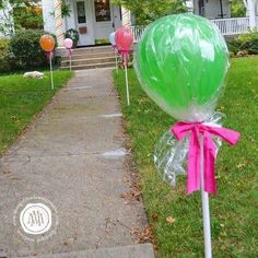 Idea for a shopkins birthday. Line sidewalk/entrance with balloons on poles, wrapped in saran wrap and tie with ribbon. Genius!