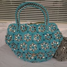 Handmade Soda Pull Tab Top Handle Bag made from 476 recycled aluminium pull tabs.  Dimension 27 x 24 x 5 cm  The tabs have been carefully cleaned and