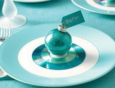 Upcycle old CDs by making them into a bright and festive DIY place card holders.