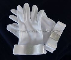 Flower Girl Gloves  White Cotton gloves for your child's next formal event. Weather its a wedding, 1st communion, etc.. these will be perfect!!   Comes in 2 sizes: S (4-6) & L (7-9)  $12.99  https://www.etsy.com/listing/153313063/bridal-flower-girl-cotton-gloves-white?ref=sr_gallery_12_search_query=Flower+girl+gloves_view_type=gallery_ship_to=US_search_type=all_facet=Flower+girl+gloves