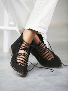 I love the way the shoes are laced up, showing some skin. But I certainly don't like the fact that it is made from leather - not cool at all!