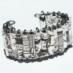 cuff style paper bead bracelet...could use old maps, newspaper, whatever
