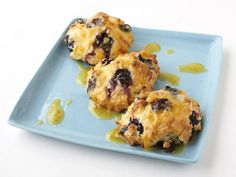 Orange Glazed Blueberry Scones - Tyler Florence. An orange juice-sugar glaze offers a touch of refreshing citrus to these berry-studded pastries.