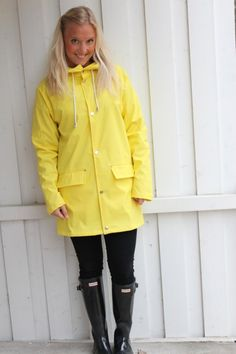 yellow rain mac and Hunter boots