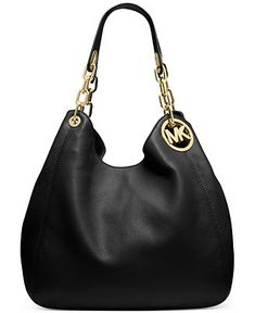 It's love at first sight with this effortlessly chic shoulder tote rendered in rich Venus leather. Gilded logo medallion detailing adds signature style, while the trio of interior compartments keeps y