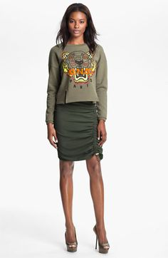 My sister is buying this Kenzo sweater in the light green...definitely going to have to steal this!