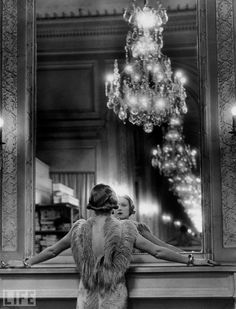 A model, wearing a gown trimmed in ostrich feathers, Molyneux atelier, circa 1934.