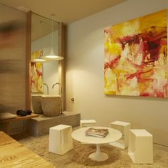 """Our reception area currently features the dramatic """"Sweatheart"""" painting by Sydney artist Tod Hunter. The water fountain is a Japanese grain bowl."""
