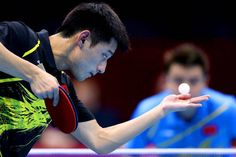 Zhang Jike of China eye on the ball during the gold medal match.