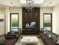 Like: dark brown contrasted with white + hanging contemporary chandelier + couch fabric pattern + white coffee table